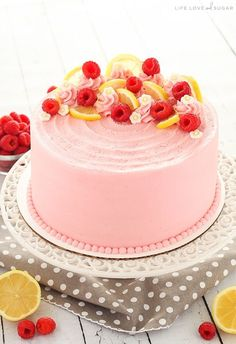 This Lemon Raspberry Layer Cake has moist, light layers of lemon cake, lemon curd filling and a raspberry frosting. It's decorated perfectly for summer!