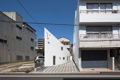 """Residential Architecture: Y House by Hideyuki Nakayama Architects: """"..the 'y house' in hiroshima, japan is designed by hideyuki nakayama architects and has been introduced by JA+U (Japan Architecture+Urbanism. a white exterior wall curves down the length of this narrow lot, creating a color-coordinated relationship with its neighbor. the 95 square meter dwelling was conceived as both a 'gray cliff' and 'white valley', using a windowless exposed concrete facade to overlook the bordering empty…"""