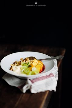 {Millet with coconut milk, vanilla soy yoghurt, fruits and nuts.}