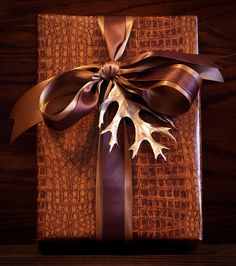 Gift wrapping for him...leather tone paper, rich browns and a gold painted leaf