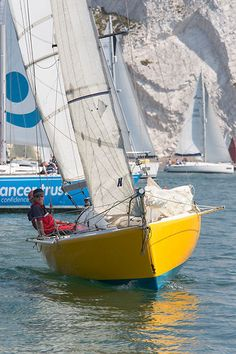 The TE Salt one design mini transat yacht 'Pimento' competing in the Round the Island Race. Sail Boats, Asset Management, One Design, Sailing Ships, Minis, Salt, Racing, Island, Pictures