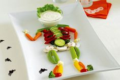 Give everyone's sweet tooth a break with this rather jaunty-looking skeleton. The dip is ranch dressing, and those limbs are actually veggies.