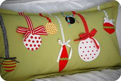 picture this pillow done in linen, with differently textured ornaments in creams/whites - sweater fabric, satin, etc.  Then use gold ribbons as accents - could be cute or more sophisticated, depends on how you dress it up :)