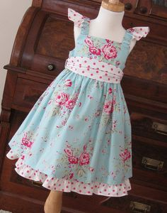 rose dress. Love the mix of fabric!