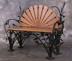 OK. Cool garden forged steel and wood chair by USBlacksmith and blacksmith Steve Joslyn in Smyrna, NY