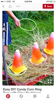 Easy DIY Candy Corn Ring Toss with Glow Necklaces for a Fun Fall, Halloween, or Thanksgiving Game – perfect for kid's school party, harvest parties, or family fun! Sac Halloween, Halloween Class Party, Halloween Birthday, Halloween Activities, Halloween Festival, Halloween Food Ideas For Kids, Haloween Games, Preschool Halloween Party, Childrens Halloween Party