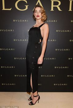 Hollywood star: Amber Heard turned up the glamour as she arrived at the Bulgari Haute Couture Cocktail Party & Model Show in Paris on Tuesday, in a stunning buttoned black dress