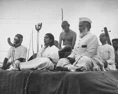 Gandhi joins, from the left, his nephew Kanu (behind the microphone), secretary Sushila Pai, Anis Ahmed, and secretary Pyarelal for a prayer meeting in 1946.