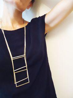 Collar con movimiento en bronce y plata 925 combinados - Realizado a mano - Moderno - minimalista - cuadrados - geométrico