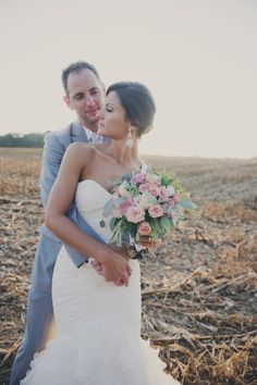Southern Savvy Events. Kristin & Joel | Bouquet | Bride | Groom | Field | Sunset | Roses | White | Blush | Greenery