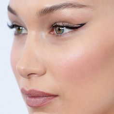 Bella Hadid with a unique cat eye makeup look. Bella Hadid serves some MAJOR cool makeup looks on red carpets and runways. Click above to see 18 beauty close-ups of Bella Hadid's makeup. #BellaHadid #BellaHadidStyle #Bellahadidmakeup