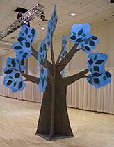 Maybe baobab tree shaped? Using a sheet of plywood, draw and cut out trunk (base is wide up to tall, then narrows to wide up to tall) and top are the leaves (I like the blue instead of green! Theatre Props, Stage Props, Tree Cut Out, Cardboard Tree, Lion King Jr, Baobab Tree, The Giving Tree, 3d Tree, Art Drawings For Kids