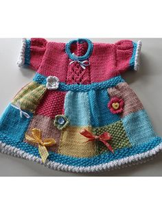 Patchwork Judy Baby Dress pattern download from e-PatternsCentral... -- A pretty patchwork dress to adorn your little one! This pattern was designed as a way to use up oddments of pretty yarns and is decorated with odd buttons, bows and ribbons left over from other projects.