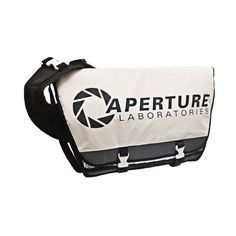 Portal 2 1980s Logo Aperture Laboratories Messenger Bag ($70) ❤ liked on Polyvore featuring bags, messenger bags, logo bags, logo messenger bag, courier bag, retro bag and retro messenger bags