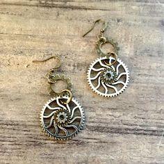 Steampunk Jewelry, Spiral Gear Earrings by OneStopSteamShoppe #Steampunk #Gears #Spiral #Earrings #SteampunkEarrings #SteampunkJewelry #SteampunkJewelry #BronzandSilver