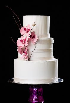 Three Tier White Cake with Orchids and pearlescent bands.