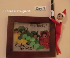 Eli the elf draws funny faces on a picture of the girlies