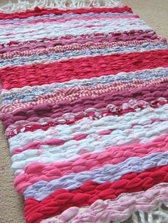 Rag rug made on a hand made peg loom using old clothes & bedding.