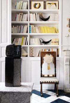 note: hinges inside trim indicate hidden cabinet doors---Black and White Living Room