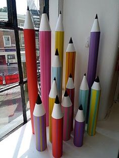 Giant colour pencils props - great idea to grab the eye at a craft fair. Use fishing line to hang above your table.