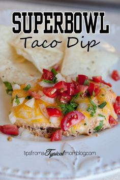 Superbowl Taco Dip recipe perfect for your Superbowl Party Appetizers.  My kids even ask me to make this for them for dinner.  It's different because it's hot and really flavorful!