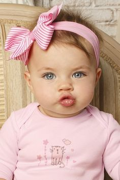 Precious little girl in pink, southern-style bow!
