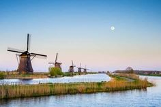 Photographic Print: Netherlands, South Holland, Kinderdijk, UNESCO World Heritage Site. The moon rises above historic D by Jason Langley : 36x24in