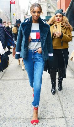 Jourdan Dunn wears a fur jacket over her shoulders to warm up her casual outfit.