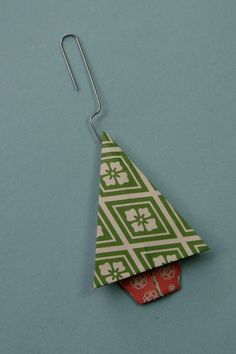 learn how to make an origami Christmas tree that can be tuned into a Christmas tree ornament