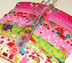 I am making a bunch of these fabric covered clothes hangers for a new kid's store opening soon! Fabric Crafts, Sewing Crafts, Sewing Projects, Diy Projects, Fabric Covered Hangers, Padded Hangers, Wooden Hangers, Kitsch, Patchwork Quilt