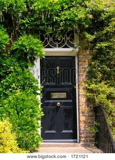English victorian front door. Surrounded by flowers.