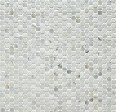 The Shower Floor Is Hexagon Shaped Marble Tiles With
