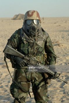 An American soldier wears a gas mask during a chemical warfare exercise in Saudi Arabia.-led coalition preparing to liberate Iraqi-occupied Kuwait. American Soldiers, American Civil War, Native American, Army Love, Us Army, Special Forces Gear, Military Weapons, Military Female, Military Mom