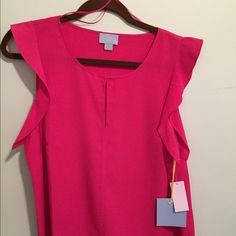 "NWT, Beautiful Deep Pink Top size LG by CeCe CeCe by Steffe is the brand name. MSRP $79. NWT deep pink top. Tag says color is ""Pink Lily"" It is made of 100% polyester with short bell sleeves and a keyhole on the front. This top is a size large. Length is 26"" and width is 21"". CeCe by Steffe Tops Blouses"