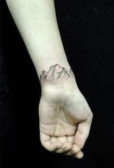 A little wrist tattoo of a mountain range. Another good design to help fight off depression and self-harm.