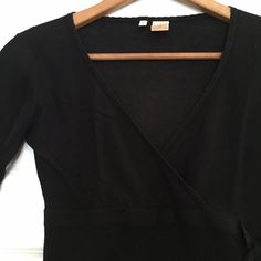 Anthro MOTH Black Tie Sweater Great Anthropologie black faux-wrap v-neck sweater by MOTH with band and tie at side, and elbow-length sleeves. 100% cotton. Size medium. Also available in lavender (see separate listing). Anthropologie Tops