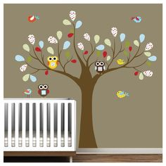 multi colored owls in tree