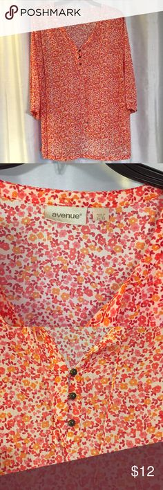 Pretty flower top This simply pretty top has orange, yellow and pink tiny flowers, cute little brass button on the sleeves and front, fabric is light weight and breezy. This top is from the Avenue and is a 3X. Avenue Tops Blouses