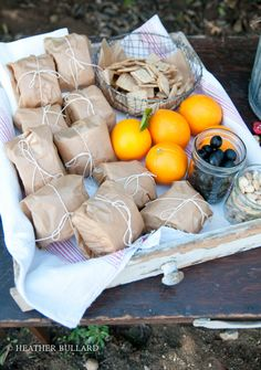 Wrap sandwiches in brown paper. Tie with string.  Picnic away.