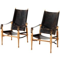 Safari Chairs in Original Black Saddle Leather, Denmark, 1960s | From a unique collection of antique and modern armchairs at https://www.1stdibs.com/furniture/seating/armchairs/