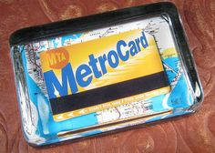 Create your own souvenir paperweights.  This paperweight pairs a New York City MetroRail card with a map of the NYC Subway system.