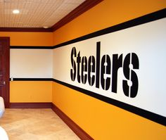 Pittsburgh Steelers 1970's Locker Room Mural by Tom Taylor of Wow Effects, painted in a home gym in Virginia.