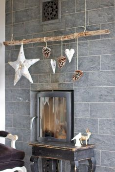 Deco Inspiration: Christmas DIY - Deco Inspiration: Christmas DIY This DIY branch with a few simple ornaments might be all the Christmas decor you need in your tiny home. Noel Christmas, Christmas Is Coming, Rustic Christmas, Winter Christmas, Christmas Branches, Christmas Fireplace, Driftwood Christmas Tree, Xmas Trees, Nordic Christmas