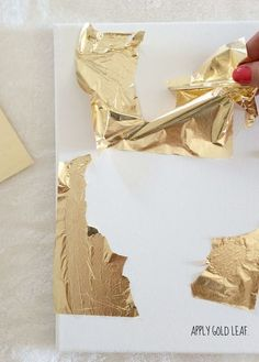 How To Make DIY Gold Leaf Abstract Art (LiveLoveDIY) Hey ya'll! I'm taking a break from renovation updates for a week or two. I can barely stand the wait, but I think it's best to let everything get finished and then share e Art Diy, Diy Wall Art, Art Feuille D'or, Cuadros Diy, Gold Leaf Art, Painting With Gold Leaf, Gold Diy, Gold Gold, Painted Leaves