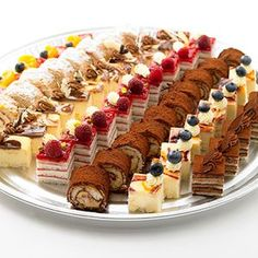 Petit Fours - can't bake? buy them (Christmas Bake Treats) Petit Fours for the people who don't have the time or can't bake . Výsledek obrázku pro petit fours offers a variety of individual desserts and dessert platters for your event needs, including D Dessert Platter, Dessert Buffet, Dessert Bars, Cake Platter, Fancy Desserts, No Bake Desserts, Delicious Desserts, Individual Desserts, Baking Desserts