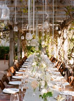 Found on WeddingMeYou.com - Garden Wedding Decoration Ideas with unique candle drops as chandeliers and lanterns   Photo by Raya Carlisle Photography