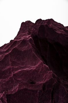 Haetriem Mountains are sometimes tinged with red. Some say it's from the blood the Nox love to spill, but really it's just the red cloud residue from the Summer.