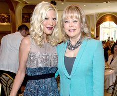 """Tori Spelling opened up about her relationship with mom Candy Spelling, telling Access Hollywood Live that her late father, Aaron Spelling, """"created a lot of the competition"""" between them"""