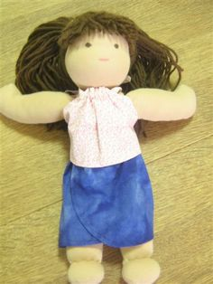 Andrea is doing my How to Make Doll Clothes Course and sent me photos of the first four bonus patterns.  Here are the Halter Top & Sarong she has made for her 14 inch Waldorf doll who looks so happy to have new clothes.
