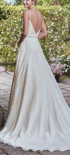 Lightweight Gatsby Gowns for a Summer Wedding - Nothing makes a chic statement like a minimalist gown in novelty-printed organza. Isolde wedding dress by Rebecca Ingram